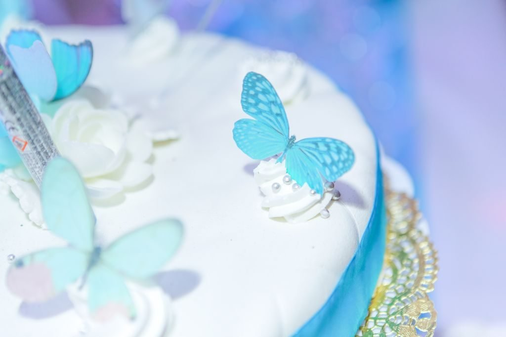 Turquoise Butterflies on Wedding Cake