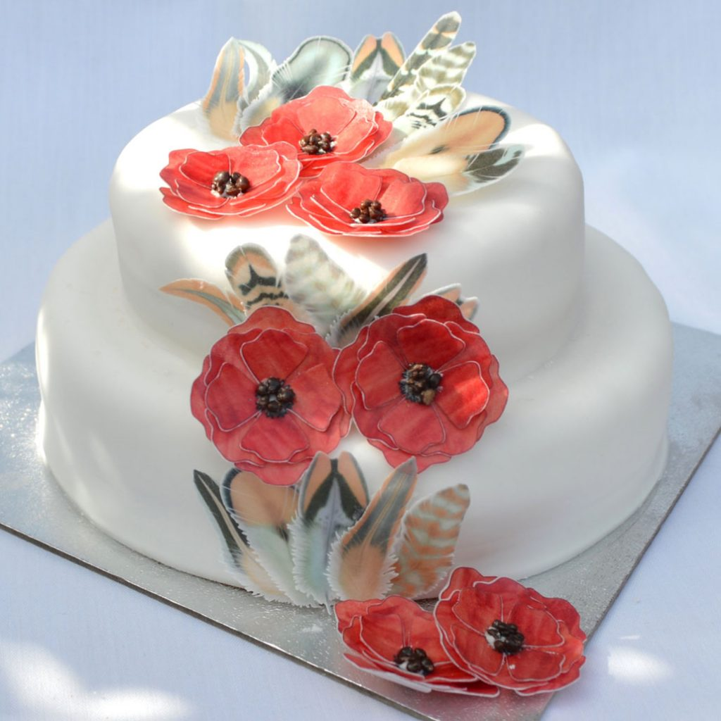 Wickstead's-Eat-Me-Edible-Chocolate-Orange-Boho-Feathers-on-3-tiered-white-cake-with-Edible-Red-Poppies