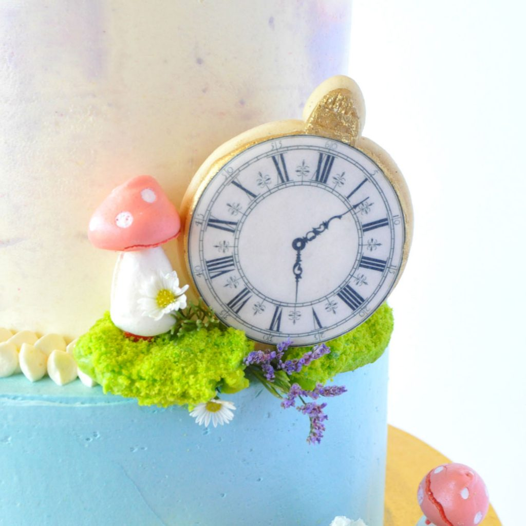 Wickstead's-Eat-Me-Edibles-Large-Clocks-on-a-biscuits-on-2-tiered-cake