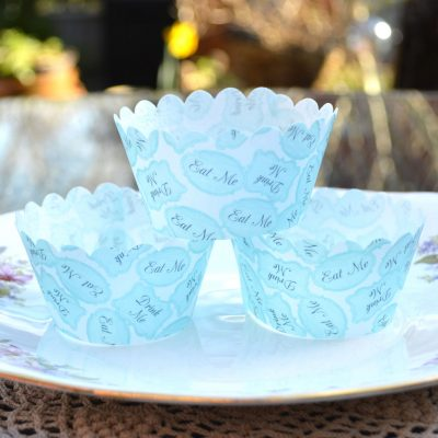 Wickstead's-Eat-Me-100%-Edible-Cupcake-Wrappers-Alice-in-Wonderland-Eat-Me-Drink-Me-Turquoise-(1)