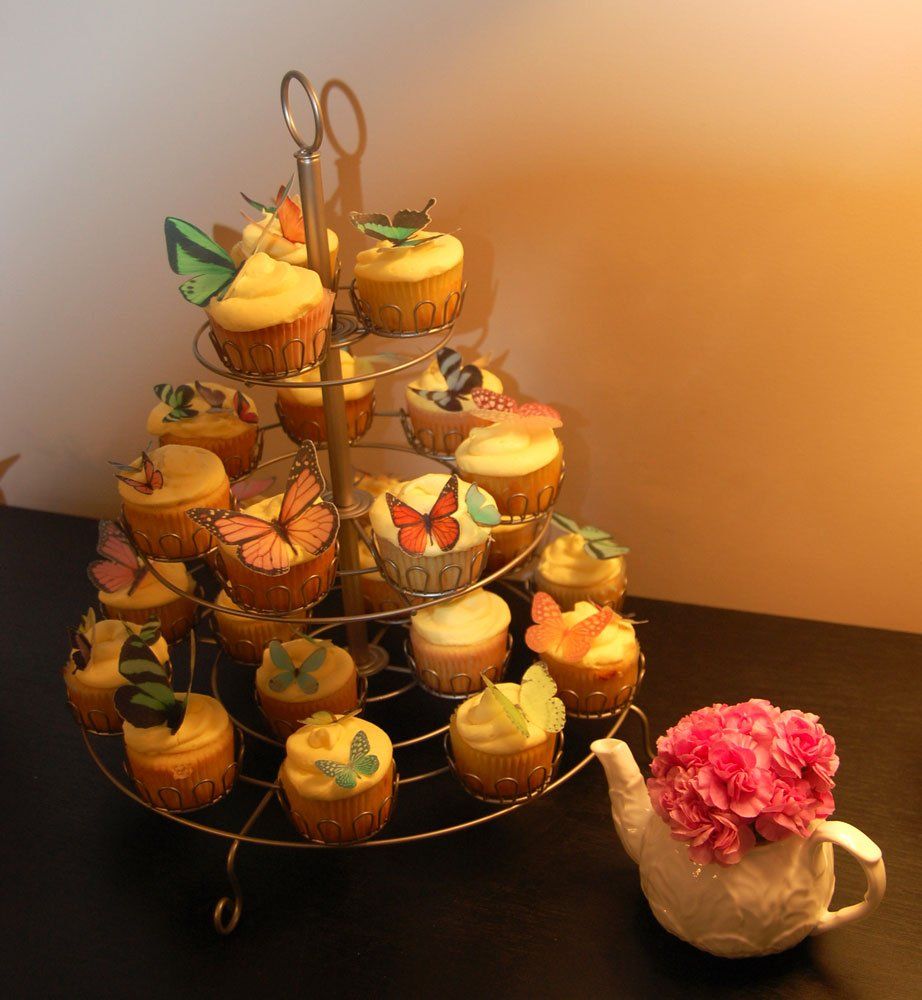 Wickstead's-Eat-Me-Customer-Photo-Butterflies-Mixture-of-colours-and-sizes-on-cupcakes