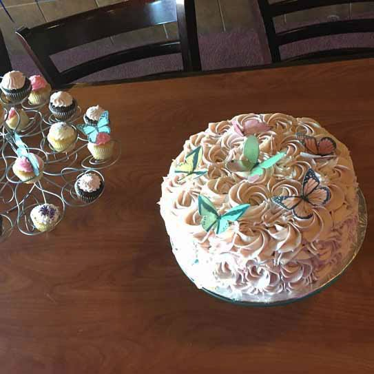 Wickstead's-Eat-Me-Customer-Photo-Butterflies-Mixture-on-swirled-cake