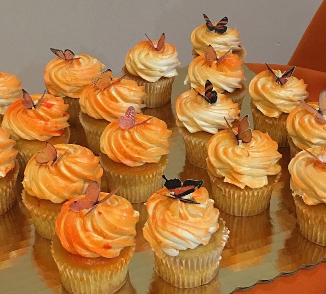Wickstead's-Eat-Me-Customer-Photo-Orange-Butterflies-on-airbrushed-cupcakes