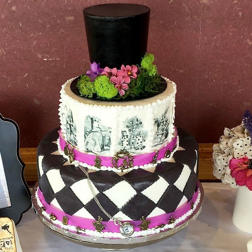 Wickstead's-Eat-Me-Edibles-Customer-Photo-of-Alice-in-Wonderland-Illustrations---Purple-Cake