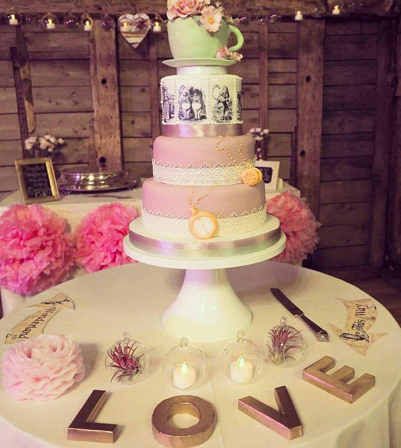 Wickstead's-Eat-Me-Edibles-Customer-Photo-of-Alice-in-Wonderland-Illustrations-Tiered-Cake