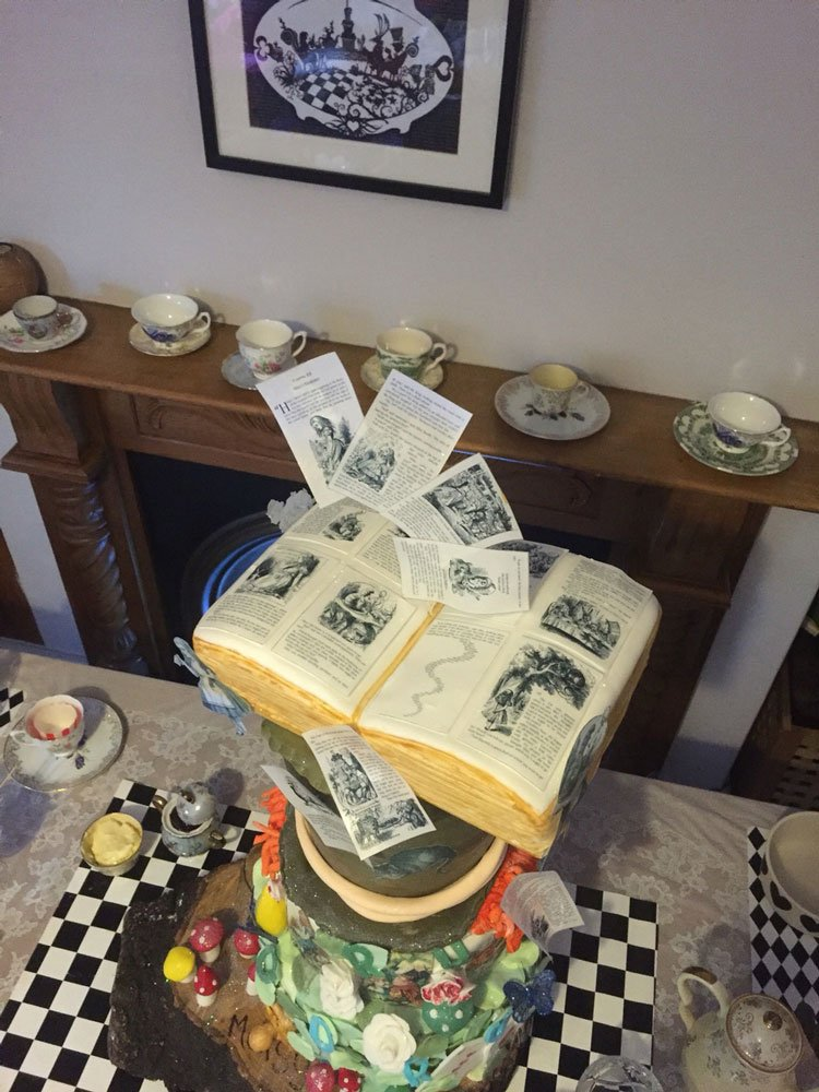 Wickstead's-Eat-Me-Edibles-Customer-Photo-of-our-Alice-Figures-&-Book-Pages-Flying-out-of-Book