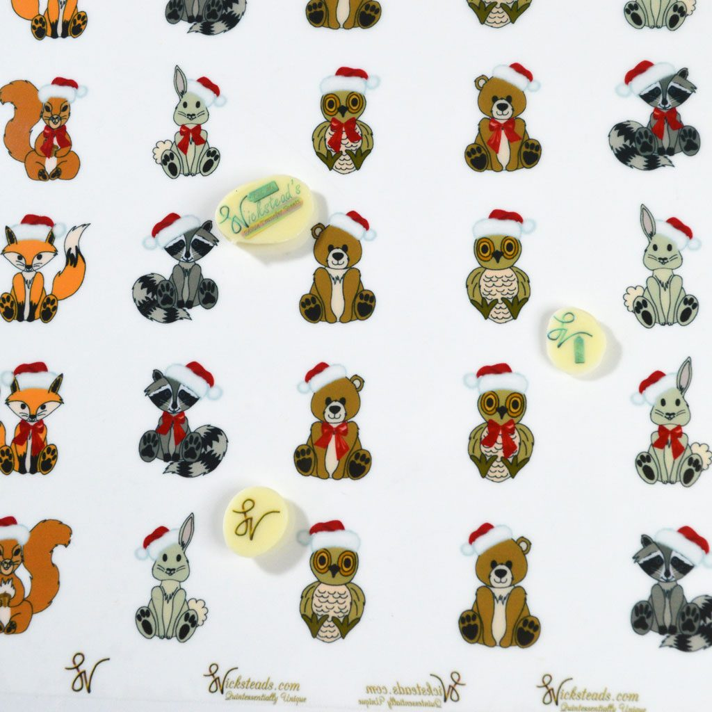 Wickstead's-Eat-Me-Edible-Meringue-&-Chocolate-Transfer-Sheets–Cute-Christmas-Animals-in-Santa-Hats-(1)
